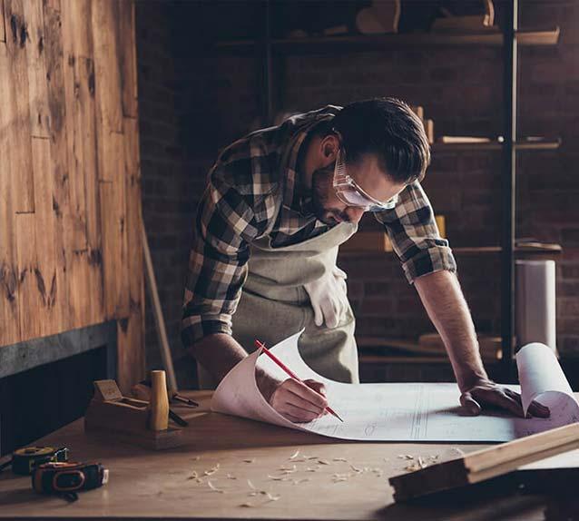 Man drawing plans
